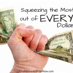 A Fist Squeezing a Dollar